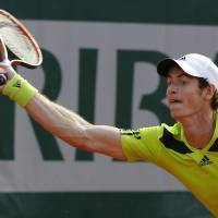 Photo - Britain's Andy Murray returns the ball during the fourth round match of the French Open tennis tournament against Spain's Fernando Verdasco at the Roland Garros stadium, in Paris, France, Monday, June 2, 2014. (AP Photo/Michel Euler)