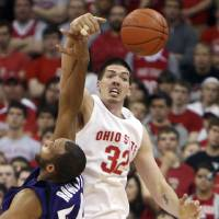 Photo - ** FOR USE AS DESIRED WITH NBA DRAFT STORIES ** FILE - In this March 8, 2009, file photo Ohio State University's B.J. Mullens (32) knocks a rebound away from Northwestern's Kyle Rowley (54) during the second half of an NCAA college basketball game in Columbus, Ohio. Mullens is a top prospect in the upcoming NBA Draft.. (AP Photo/Terry Gilliam, File) ORG XMIT: NY217 Byron Mullens