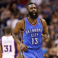 Photo -   FILE - This April 18, 2012 file photo shows Oklahoma City Thunder guard James Harden reacting to a three-pointer against the Phoenix Suns during the second half of an NBA basketball game, in Phoenix. Harden's dominant fourth-quarter performance in a clinching Game 4 victory against Dallas was only the latest step in his recent rise to prominence. (AP Photo/Matt York, File)