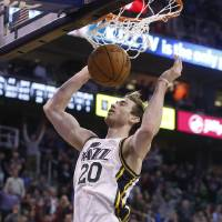 Photo - Utah Jazz guard Gordon Hayward (20) gets a dunk against the Oklahoma City Thunder during the second half of an NBA basketball game in Salt Lake City, Tuesday, Jan. 7, 2014. The Jazz won 112-101. (AP Photo/Jim Urquhart)