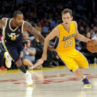 Photo -   Utah Jazz guard Mo Williams (5) grabs Los Angeles Lakers guard Steve Nash (10) shirt as he gets by him during the first half of an NBA preseason basketball game, Saturday, Oct. 13, 2012, in Los Angeles. (AP Photo/Gus Ruelas)