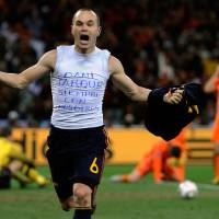 Photo - FILE - In this July 11, 2010 file photo, Spain's Andres Iniesta celebrates after scoring a goal, with the words