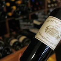 Photo - In this Sept. 20 2012, photo, a wine seller presents a 2005 bottle of Bordeaux wine Chateau Margaux at his shop in Paris. The United States wants to sell some of their wines in the European Union with a ''chateau'' label.  Next week, EU experts will look whether it should permitted with a fight among member states set for later this year, well after the wine harvest. (AP Photo/Remy de la Mauviniere)