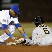 Photo - Chicago Cubs shortstop Starlin Castro loses the ball as Pittsburgh Pirates Starling Marte steals second during the eighth inning of the MLB National League baseball game on Tuesday, April 8, 2014, in Chicago. (AP Photo/Andrew A. Nelles)