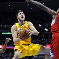 Photo - Denver Nuggets forward Danilo Gallinari (8), of Italy, shoots against Los Angeles Clippers center DeAndre Jordan (6) during the third quarter of an NBA basketball game, Tuesday, Jan. 1, 2013, in Denver. (AP Photo/Jack Dempsey)