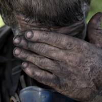 Photo - In this picture taken on Tuesday, May 20, 2014, a Ukrainian miner wipes his face after finishing his shift at a coal mine in Donetsk, Ukraine. In the roiling debate over eastern Ukraine, where pro-Russian separatist attacks have turned increasingly bloody, neither the country's richest man nor some of his dirt-poor compatriots have much time for patriotism, ethnic feuding or political parties. (AP Photo/Vadim Ghirda)