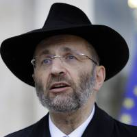 "Photo - FILE - In this July 12, 2012 file photo, France's Grand Rabbi Gilles Bernheim talks to the media after his meeting with French President Francois Hollande at the Elysee Palace in Paris. French Jewish leaders were holding an urgent meeting to discuss the career fate of France's chief rabbi  Bernheim after he acknowledged ""mistakes"" amid allegations that he plagiarized texts and lied about his educational background.(AP Photo/Francois Mori, File)"