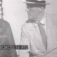 Photo - This image from an eight-second film clip provided by the National Archives shows President Franklin Delano Roosevelt, right, aboard the U.S.S. Baltimore in Pearl Harbor in July 1944, depicting a secret not revealed to the public until after his death. Person at left is unidentified. (AP Photo/National Archives)