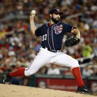 Photo - Washington Nationals starting pitcher Tanner Roark throws during the fourth inning of a baseball game against the Pittsburgh Pirates at Nationals Park, Friday, Aug. 15, 2014, in Washington. (AP Photo/Alex Brandon)
