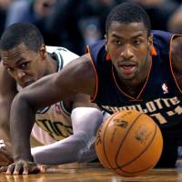 Photo - Charlotte Bobcats forward Michael Kidd-Gilchrist, right, and Boston Celtics guard Rajon Rondo, left, chase a loose ball during the second half of an NBA basketball game in Boston, Monday, Jan. 14, 2013. (AP Photo/Charles Krupa)