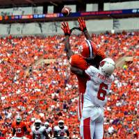 Photo -   Clemson wide receiver DeAndre Hopkins pulls in a reception for a touchdown while being covered by Ball state's Jason Pinkston in the first half of an NCAA college football game Saturday, Sept. 8, 2012 at Memorial Stadium in Clemson S.C. (AP Photo/ Richard Shiro)