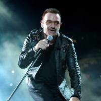 Photo - Bono performs onstage during the U2 360 opener at the Camp Nou stadium on June 30, 2009 in Barcelona, Spain. ORG XMIT: 00000000