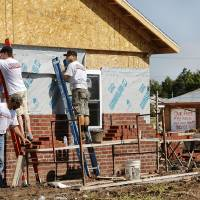 Photo - The first home in the tornado-damaged area east of Interstate 35 in Moore is being rebuilt. The home, at 113 SW 8, was destroyed by an EF-5 tornado on May 20. A volunteer non-profit organization from Virginia called Operation Blessing is rebuilding the home at the same location. PHOTO BY JIM BECKEL, THE OKLAHOMAN  Jim Beckel - THE OKLAHOMAN