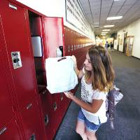 Photo - Eighth-grader Kaylee Kerr  opens her locker at Yukon Middle School, Thursday,  August 15, 2013. Photo By Steve Gooch, The Oklahoman