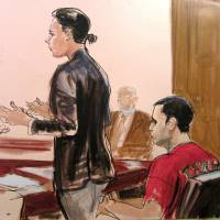 Photo - FILE - In this Oct. 25, 2012, file courtroom drawing, federal defender Julia Gatto requests bail for her client, New York City police Officer Gilberto Valle, right, at Manhattan Federal Court in New York. A federal judge has overturned the conviction of Valle, who was accused of kidnapping, killing and eating young women. According to reports, the judge ruled late Monday, June 30, 2014, there was insufficient evidence to support Valle's conviction. He acquitted Valle of kidnapping conspiracy charges. Valle could have faced life in prison. (AP Photo/Elizabeth Williams, File)