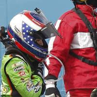 Photo - Danica Patrick heads to the infield medical center after crashing during the NASCAR Sprint Cup Series auto race, Sunday, March 3, 2013, in Avondale, Ariz. (AP Photo/Matt York)