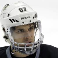 Photo - Pittsburgh Penguins' Sidney Crosby participates NHL hockey practice in Canonsburg, Pa., Tuesday, April 30, 2013. The Penguins take on the New York Islanders in the first round of the NHL hockey playoffs on Wednesday, May 1, in Pittsburgh. Crosby hasn't played since breaking his jaw a month ago. (AP Photo/Gene J. Puskar)