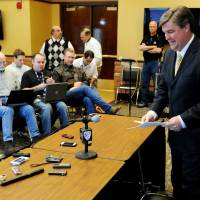 Photo - Colorado head coach Mike MacIntyre prepares to talk about his first recruiting class on signing day at an NCAA college football news conference, Wednesday, Feb. 6, 2013, in Boulder, Colo. (AP Photo/The Daily Camera, Cliff Grassmick) NO SALES; MAGS OUT; TV OUT