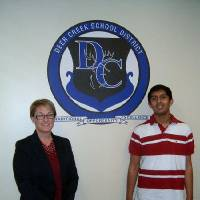 Photo - Deer Creek High School Principal Tracy Skinner poses with Soorajnath Boominathan, 14, who recorded a perfect ACT score. PHOTO BY STEVE GUST, FOR THE OKLAHOMAN