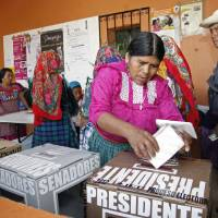 Photo -   A woman casts her ballot at a polling station in Oaxaca, Mexico, Sunday, July 1, 2012. Mexico's more than 79 million voters head to the polls Sunday to elect a president, who serves one six-year term, as well as 500 congressional deputies and 128 senators. (AP Photo/ Luis Alberto Cruz)