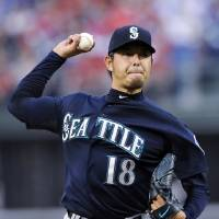 Photo - Seattle Mariners starting pitcher Hisashi Iwakuma throws a pitch in the first inning of an interleague baseball game against the Philadelphia Phillies on Tuesday, Aug. 19, 2014, in Philadelphia. (AP Photo/Michael Perez)
