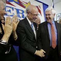 Photo - Former presidential candidate and U.S. House Speaker Newt Gingrich, right, and U.S. Sen. Pat Roberts laugh during an appearance for Robert's Senate re-election campaign Friday, Nov. 8, 2013, in Overland Park, Kan. (AP Photo/Charlie Riedel)