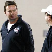 Photo - Oklahoma head coach Bob Stoops, left, talks with Paul Guenther, left, of the Cincinnati Bengals  at Oklahoma's Pro Day footbal workout in Norman, Okla., Tuesday, March 8, 2011.  (AP Photo/Sue Ogrocki)