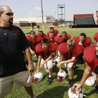 Photo - The Morrison Wildcats high school football team will make the change from 8-man to 11-man team as the school begins the season as a member of the Class A division for the first time. Football coach Cory Bales with his players at an afternon practice.  Photo taken in Morrison on Wednesday,  Aug, 28, 2008.  BY JIM BECKEL, THE OKLAHOMAN ORG XMIT: KOD