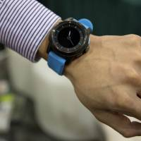 Photo - The Cookoo watch is modeled at the Consumer Electronics Show, Wednesday, Jan. 9, 2013, in Las Vegas. The watch allows users to stay connected with their mobile devices alerting them of incoming calls, emails or text messages. (AP Photo/Julie Jacobson)