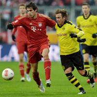 Photo - Bayern's Javier Martinez of Spain, left, and Dortmund's Mario Goetze challenge for the ball during the German first division Bundesliga soccer match between FC Bayern Munich and Bourussia Dortmund  in Munich, Germany, Saturday, Dec. 1, 2012. (AP Photo/Kerstin Joensson)