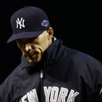 Photo -   New York Yankees manager Joe Girardi walks off the field after speaking with an umpire in the first inning of Game 2 of the American League division baseball series against the Baltimore Orioles on Monday, Oct. 8, 2012, in Baltimore. Baltimore won 3-2. (AP Photo/Alex Brandon)