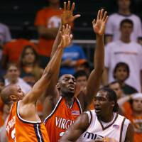 Photo - Miami forward Dwayne Collins, right, looks for an open teammate past Virginia guard J.R. Reynolds, left, and center Tunji Soroye during the second half of basketball Wednesday, Feb. 21, 2007 in Coral Gables, Fla. Miami defeated 24th ranked Virginia 68-60. (AP Photo/Wilfredo Lee) ORG XMIT: 1006202155051859