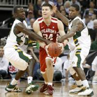 Photo - OU's Cade Davis tries to get past Baylor's Stargell Love, left, and A.J. Watson during the college basketball Big 12 Championship tournament game between the University of Oklahoma and Baylor in Kansas City, Mo., Wednesday, March 9, 2011.  Photo by Bryan Terry, The Oklahoman