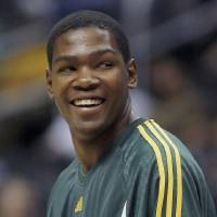 Photo - ** FILE ** In this Nov. 4, 2007 file photo, Seattle SuperSonics' Kevin Durant warms up at the start of an NBA basketball game  against the Los Angeles Clippers in Los Angeles.  Durant  has been chosen as the NBA Rookie of Year, The Associated Press has learned. The honor was first reported by The Seattle Times on Wednesday's April 30, 2008. (AP Photo/Gus Ruelas, File) ORG XMIT: NY163