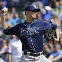 Photo - Tampa Bay Rays starter Jake Odorizzi throws against the Chicago Cubs during the first inning of an interleague baseball game in Chicago, Saturday, Aug. 9, 2014. (AP Photo/Nam Y. Huh)