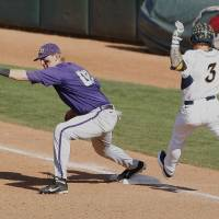 Photo - TCU first baseman Kevin Cron catches a throw from second for the TCU out in the sixth inning of a second-round game of the Big 12 conference NCAA college baseball tournament in Oklahoma City, Thursday, May 22, 2014. (AP Photo/Alonzo Adams)