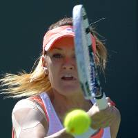 Photo - Agnieszka Radwanska, of Poland, returns a volley during a second round match at the BNP Paribas Open tennis tournament against Heather Watson, of Great Britain, Friday, March 7, 2014 in Indian Wells, Calif. (AP Photo/Mark J. Terrill)