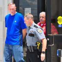 Photo - Former Oklahoma City Thunder announcer James Miller is escorted out of the Pontotoc County Courthouse Tuesday. Six counts of child sexual abuse were filed against him.  Photo by Randy Mitchell, Ada Evening News