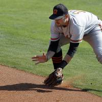 Photo - OU / OSU / BIG 12 TOURNAMENT / COLLEGE BASEBALL: Oklahoma State's Robbie Rea fields a grounder during the Big 12 baseball tournament game between Oklahoma State University and the University of Oklahoma at the Chickasaw Bricktown Ballpark in Oklahoma City,  Wednesday, May 23, 2012. Photo by Sarah Phipps, The Oklahoman.