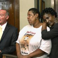 Photo - This photo shows David Slane talking to the media in his law offices after meeting with the district attorney. At right are Deidra Hill, Howard;s sister,  center, and Cynthia Hill, sister-in-law of Howard.  Oklahoma City attorney David Slane, left,  accompanied the mother, sister and widow of Robin Howard in a lengthy meeting with District Attorney David Prater in his office Wednesday afternoon, Oct. 17, 2012.  Prater told them he had decided not to file charges in the death of Howard, who died after being arrested by Oklahoma City police. The medical examiner ruled Howard's death to be a homicide. Howard's family is accusing the police department of covering up details about his death.      Photo by Jim Beckel, The Oklahoman