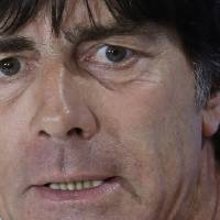 Photo - German national soccer team head coach Joachim Loew attends a news conference after an official training session one day before the World Cup semifinal soccer match between Brazil and Germany at the Mineirao Stadium in Belo Horizonte, Brazil, Monday, July 7, 2014. (AP Photo/Matthias Schrader)