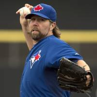 Photo - Toronto Blue Jays starter R.A. Dickey throws a warmup pitch in first inning against the Philadelphia Phillies in an exhibition baseball game in Dunedin, Fla.,  Thursday Feb. 27, 2014. (AP Photo/The Canadian Press, Frank Gunn)