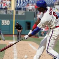 Photo - Philadelphia Phillies' Domonic Brown strikes out swinging to end the eighth inning of a baseball game against the Atlanta Braves, Sunday, June 29, 2014, in Philadelphia. The Braves won 3-2. (AP Photo/Tom Mihalek)