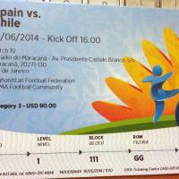 "Photo - This June 4, 2014 photo shows a $90 U.S. dollar FIFA ticket for the Spain vs. Chile World Cup game, bought by a fan on Stubhub.com, a website that connects buyers and sellers, for $775 U.S. dollars, in San Juan, Puerto Rico. Brazilian police have widened their investigation into ticket scalping at the World Cup to include ""the participation of someone from FIFA"" as a source of tickets being resold on the street for many time their face value. (AP Photo)"