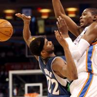 Photo - Oklahoma City's Kevin Durant is fouled by Minnesota's Corey Brewer during their NBA basketball game at the Ford Center in downtown Oklahoma City on Sunday, April 4, 2010. The Thunder beat the Timberwolves 116-108. Photo by John Clanton, The Oklahoman ORG XMIT: KOD