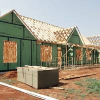 Photo - Phil Boevers has this house under construction at 3510 Coyoteee Run in the Coyoteee Springs addition in Piedmont.  PAUL B. SOUTHERLAND - The Oklahoman