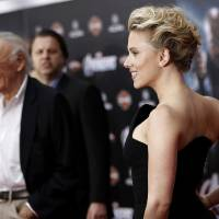 Photo - Scarlett Johansson, right, with Stan Lee at the premiere of