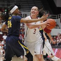Photo - Stanford's Mikaela Ruef drives toward the basket past California's Courtney Range during the first half of an NCAA college basketball game, Thursday, Jan. 30, 2014 in Berkeley, Calif. (AP Photo/George Nikitin)
