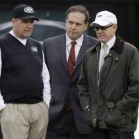 Photo - FILE - In this Dec. 2, 2012, file photo, New York Jets head coach Rex Ryan, left, stands with general manager Mike Tannenbaum, center, and owner Woody Johnson before an NFL football game against the Arizona Cardinals in East Rutherford, N.J. Ryan insists he's a Jet all the way and wants to coach the team for the