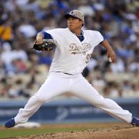 Photo - Los Angeles Dodgers starting pitcher Hyun-Jin Ryu throws in the fourth inning of a baseball game against the Cincinnati Reds, Monday, May 26, 2014, in Los Angeles. (AP Photo/Gus Ruelas)